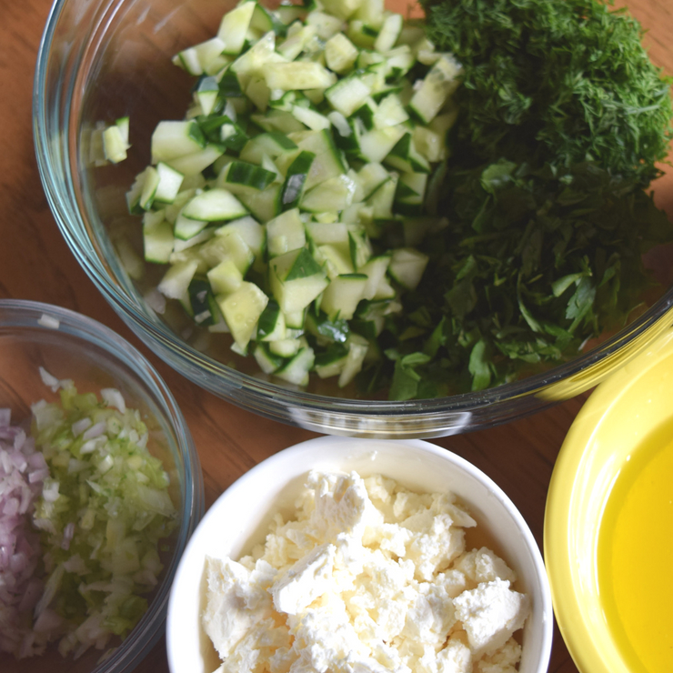 bowls of prepped salad ingredients
