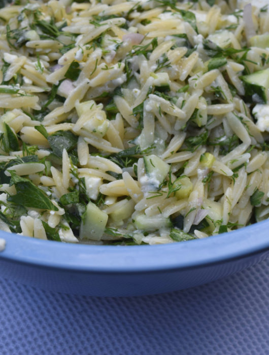 big bowl of herbed feta orzo salad