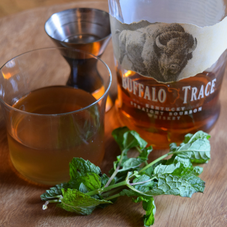 image of mint simple syrup, buffalo trace bourbon bottle, and fresh mint to make a mint julep