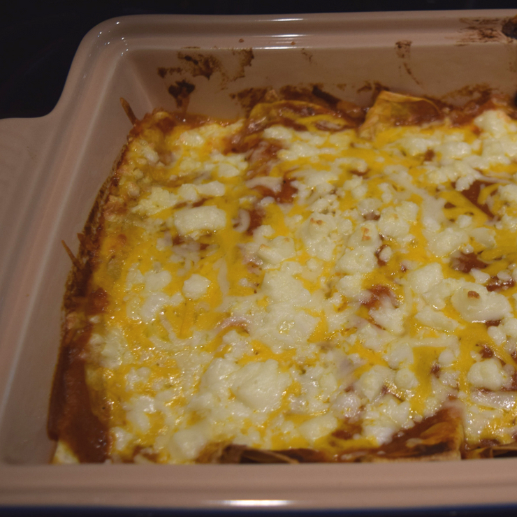 melted cheese from a pan of enchiladas