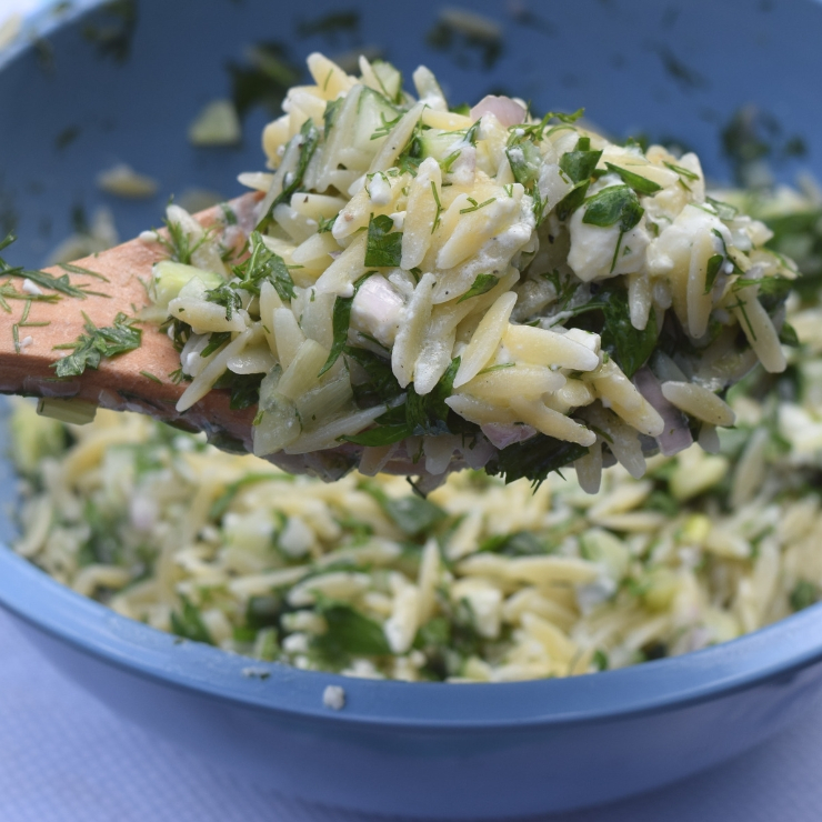 close up of spoonful of feta herb orzo salad