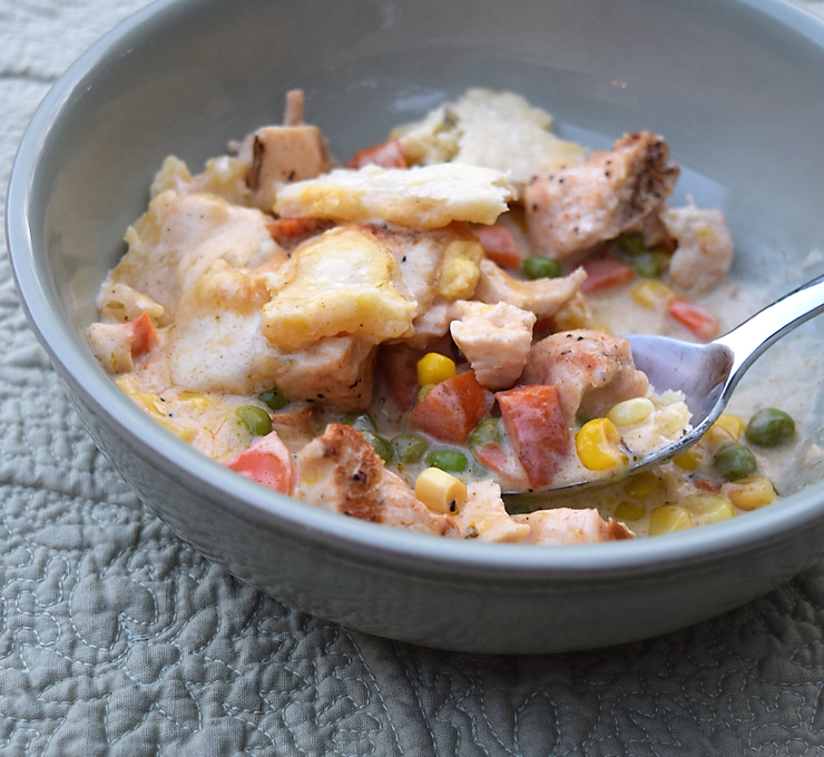 spoon in a bowl of chicken pot pie