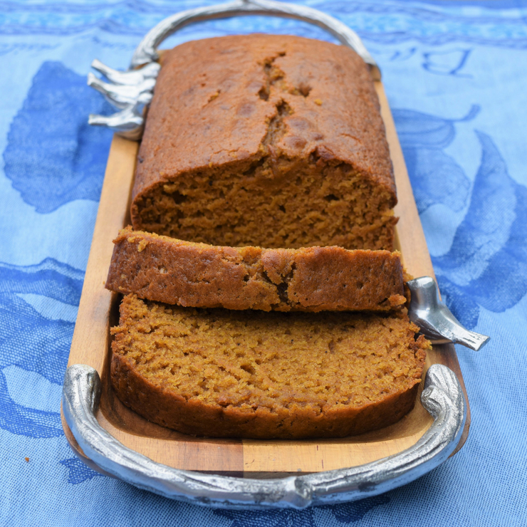 sliced loaf of pumpkin bread on a wooden tray