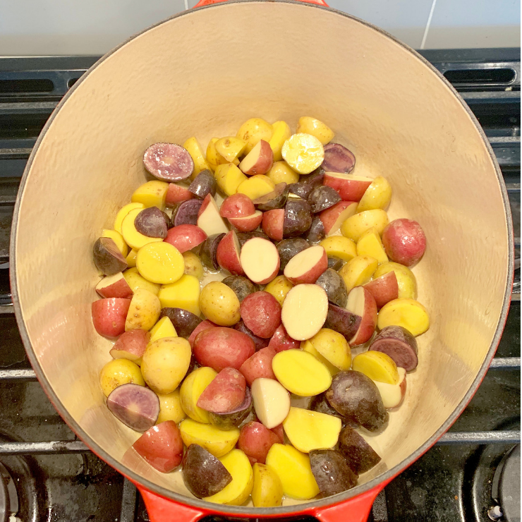 tri-color potatoes cooking in a large pot