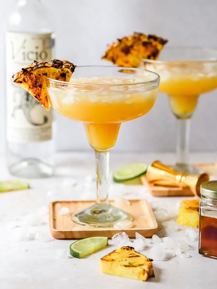 mezcal margarita with grilled pineapple garnish